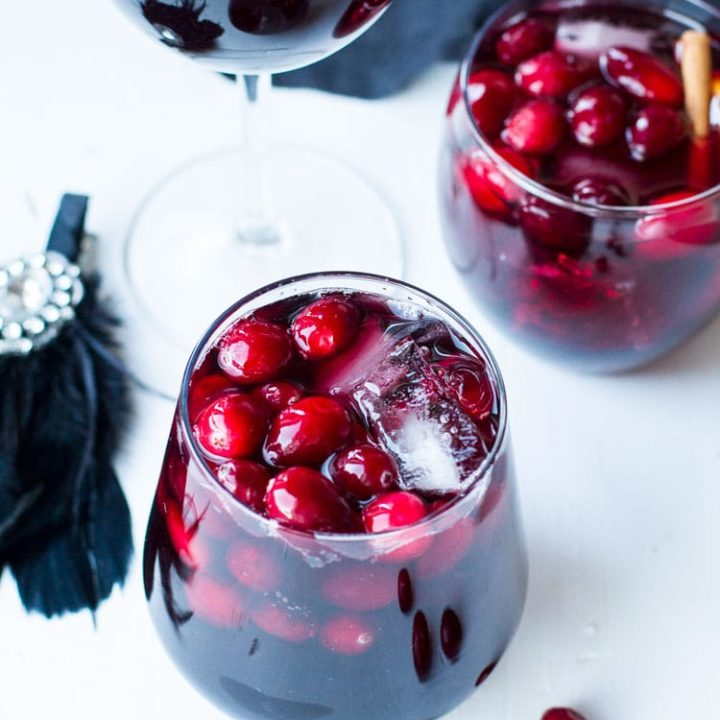Wine glasses with fresh cranberries.