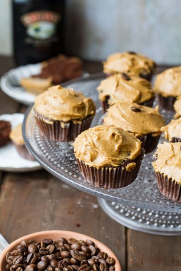 A cake stand with chocolate cupcakes and Baileys frosting.
