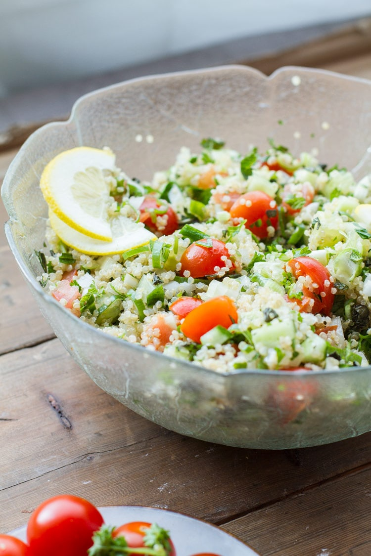 Tabbouleh in a large glass bowl. Bakclighting.