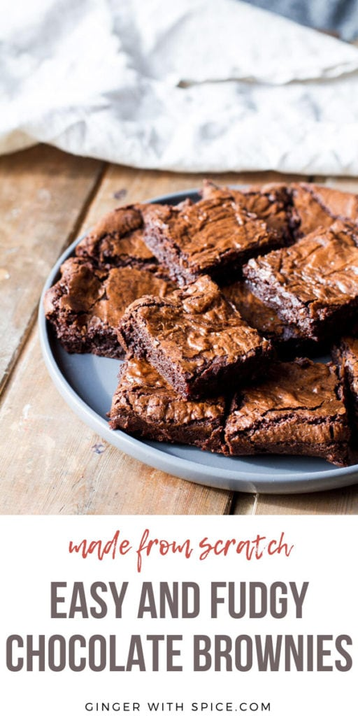 Stacks of brownies on a large plate. Pinterest pin.