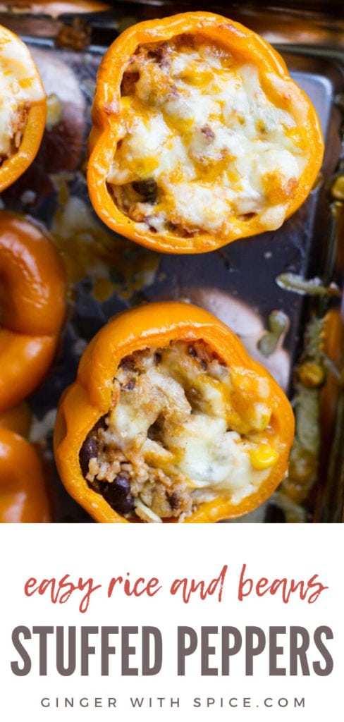 Stuffed orange bell peppers with rice and beans and melted cheese. Closeup. Pinterest pin.