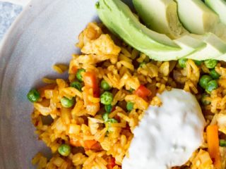 Close-up of Mexican fried rice in a blue bowl.