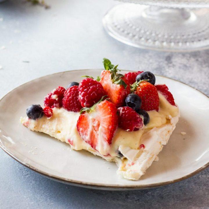 Pavlova recipe square photo of sliced pavlova cake.