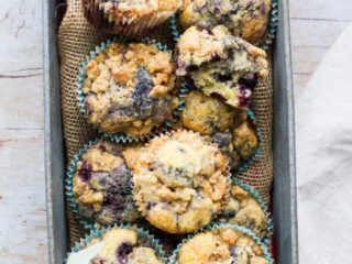 Homemade blueberry muffins in a metal box.