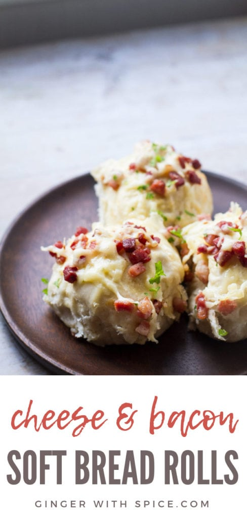 Three bacon and cheese dinner rolls on a wooden plate. Pinterest pin.