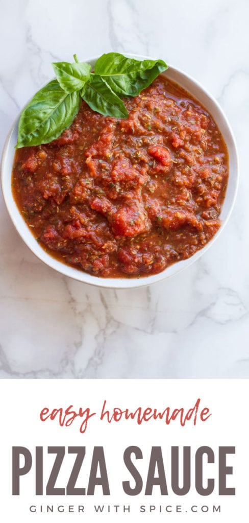 Homemade Pizza Sauce, garnished with fresh basil. Pinterest pin.