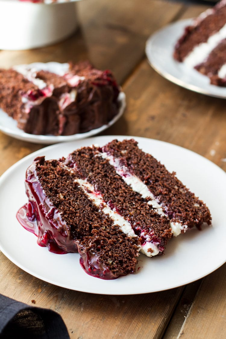One slice of black forest cake, with layers of whipped cream and cherry filling.