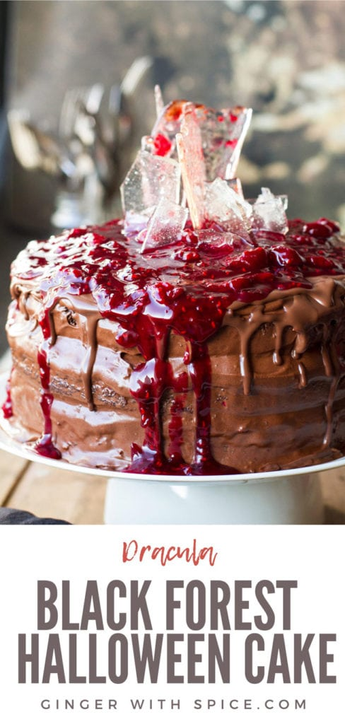 Cherry chocolate cake topped with cherry filling and sugar glass shards, close up. Pinterest pin.