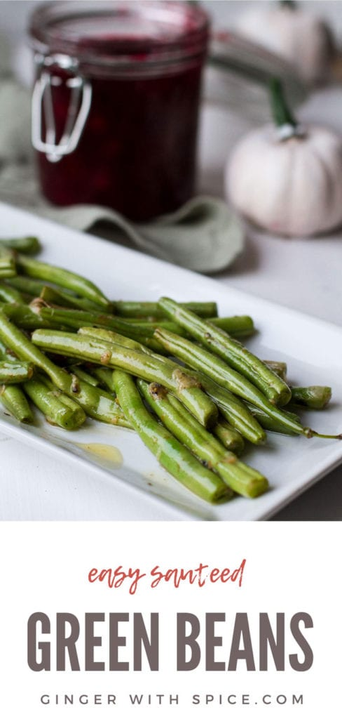 Sauteed green beans on a white, rectangular plate. Pinterest pin.