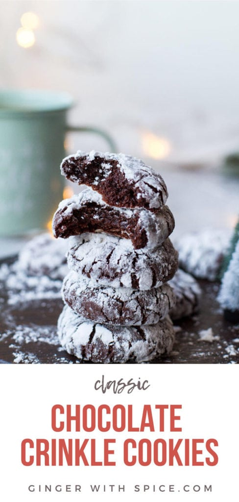 A stack of chocolate crinkle cookies, two top cookies are torn in two. Pinterest pin.