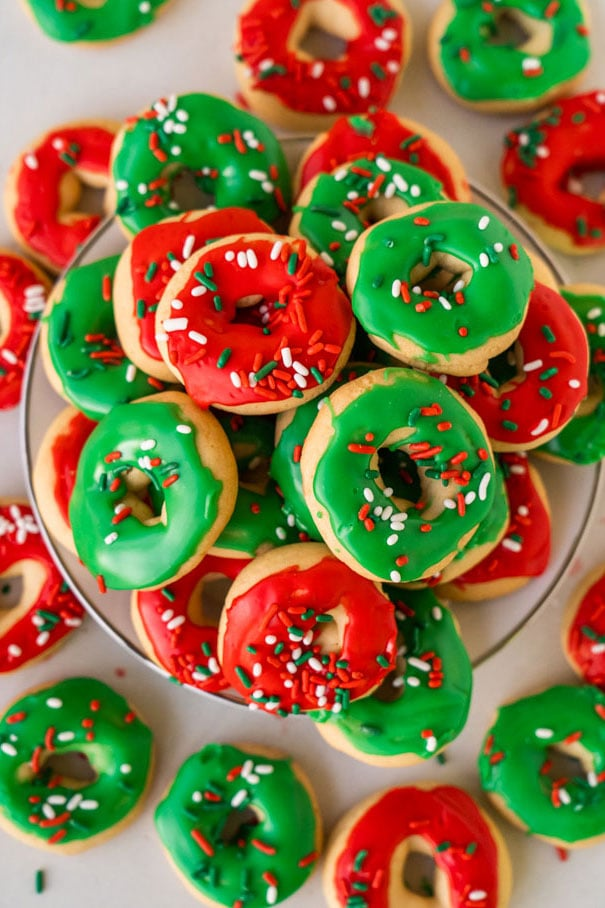Sugar cookies decorated as donuts with green and red glazing.