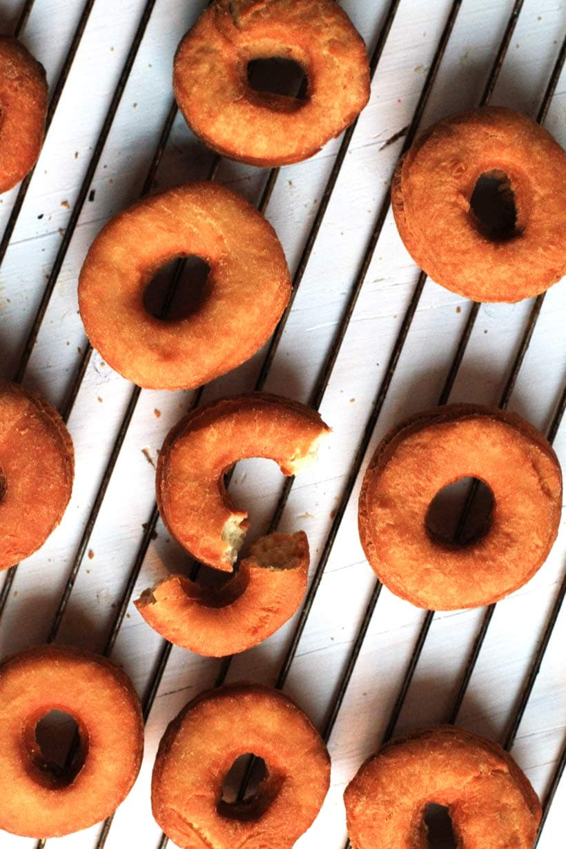 Donuts, unglazed on a cooling rack.