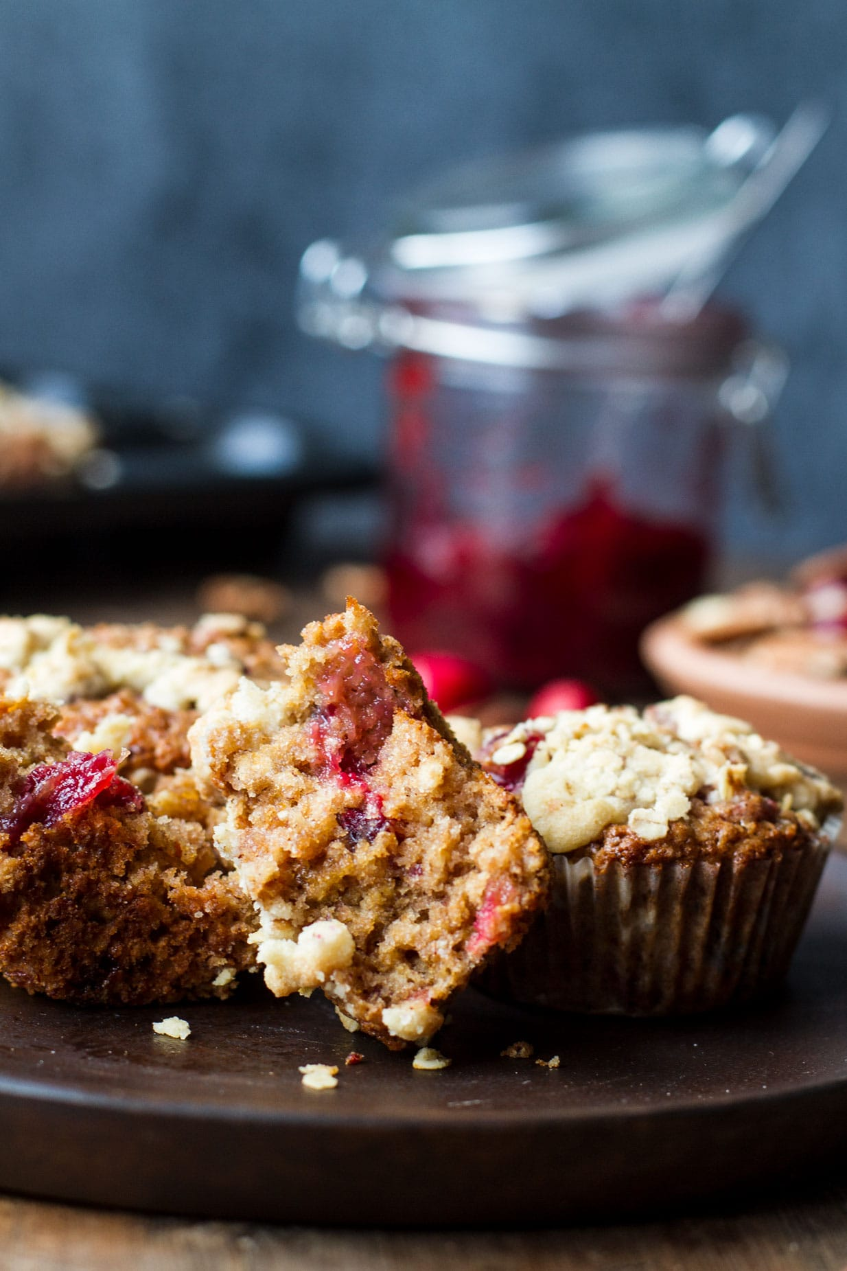 One cranberry sauce breakfast muffins open in half.