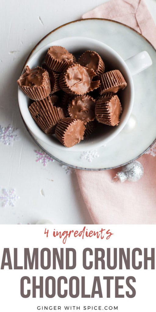 Almond Crunch Milk Chocolates, a few cut open, in a small white cup. Flatlay, pinterest pin.