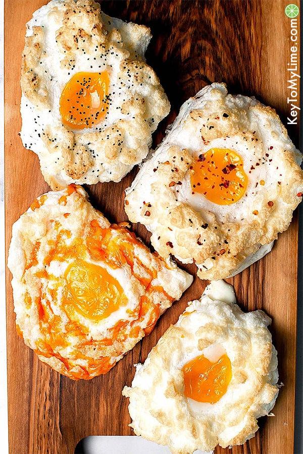 4 cloud eggs on a cutting board.