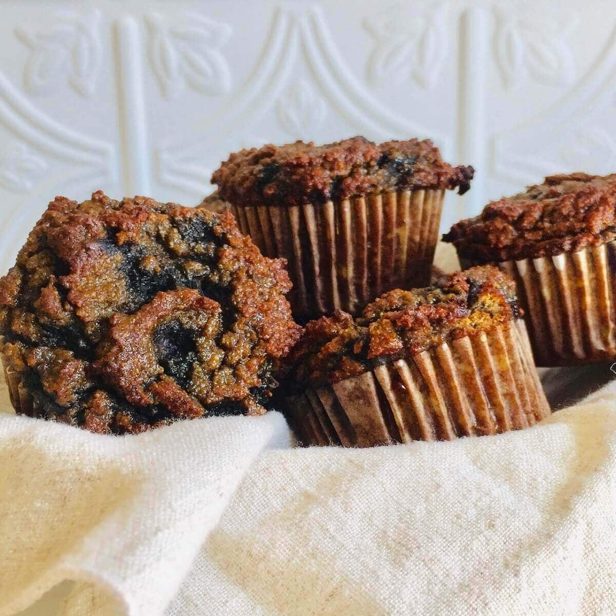 Healthy Blueberry Muffins in a light colored towel.