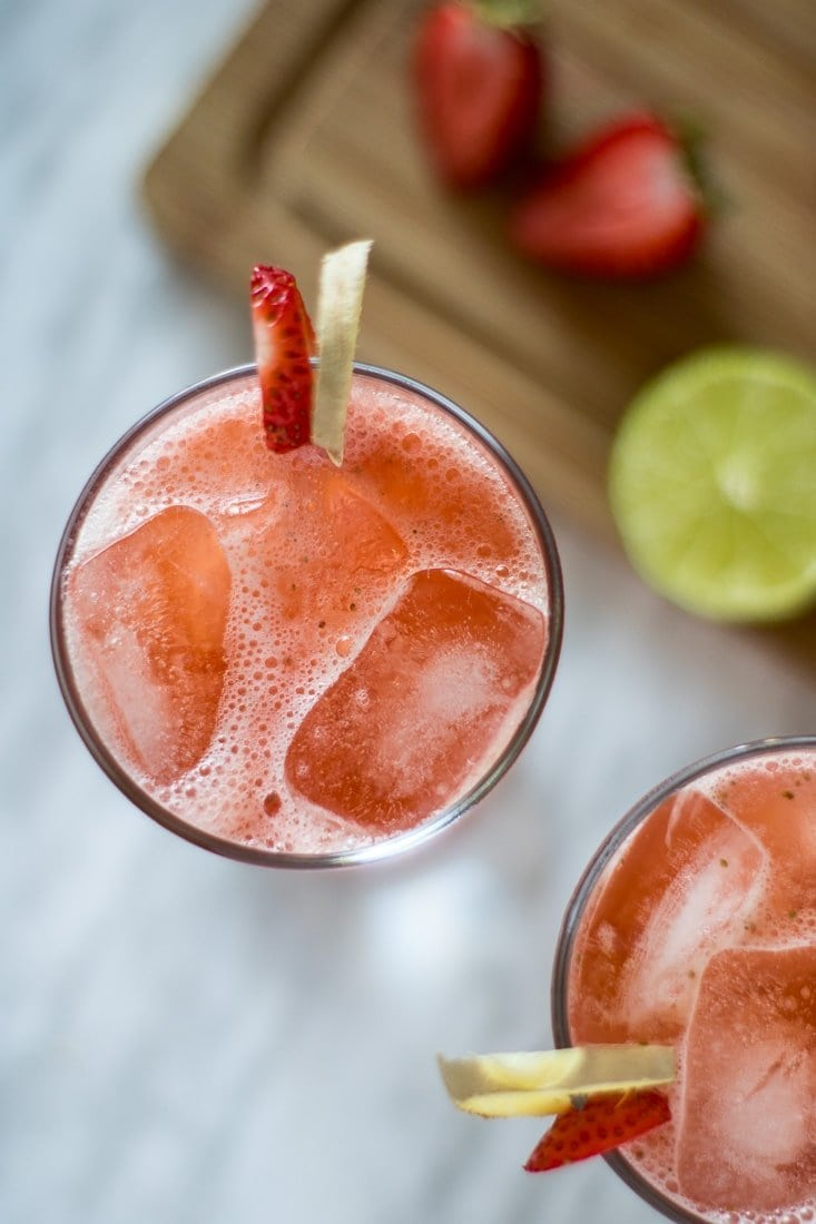 A glass with strawberry detox juice and ice cubes.