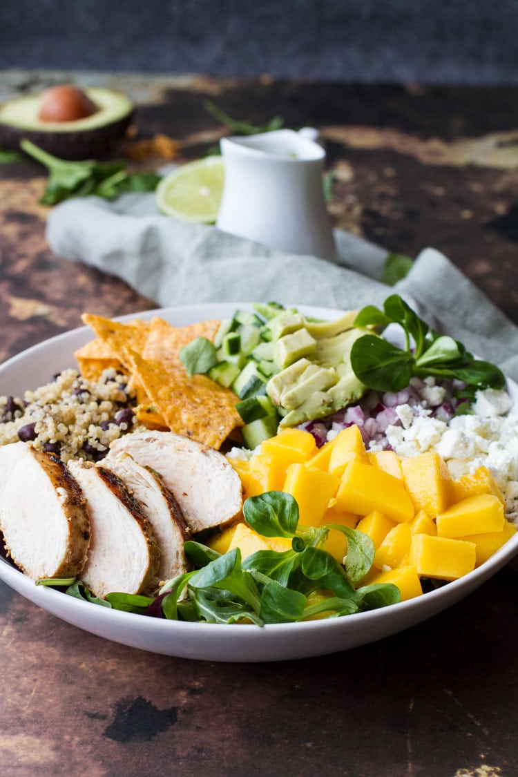 Loaded Mexican salad with mango, chicken, tortilla chips and quinoa.