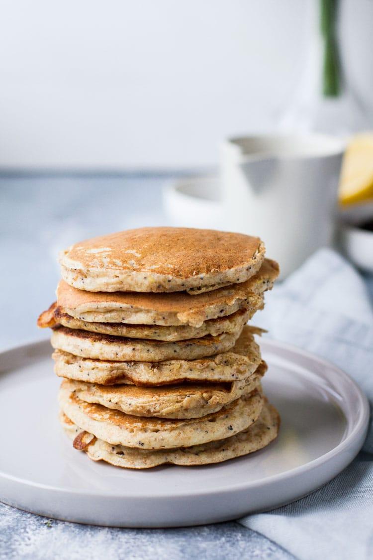 A stack of lemon poppy seed ricotta pancakes.