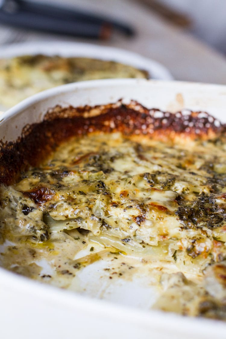 Showing the layers of scalloped potatoes in a casserole.