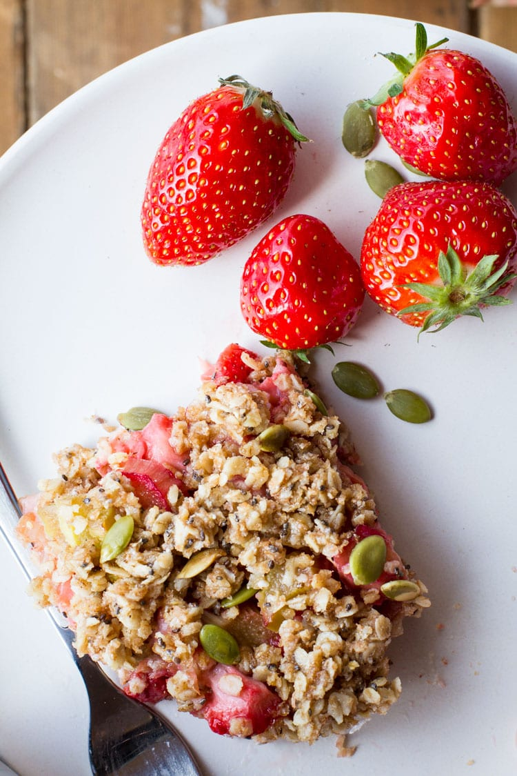 Close-up of the oatmeal bar and some fresh strawberries.