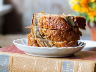Three slices of banana bread stacked on top of each other.