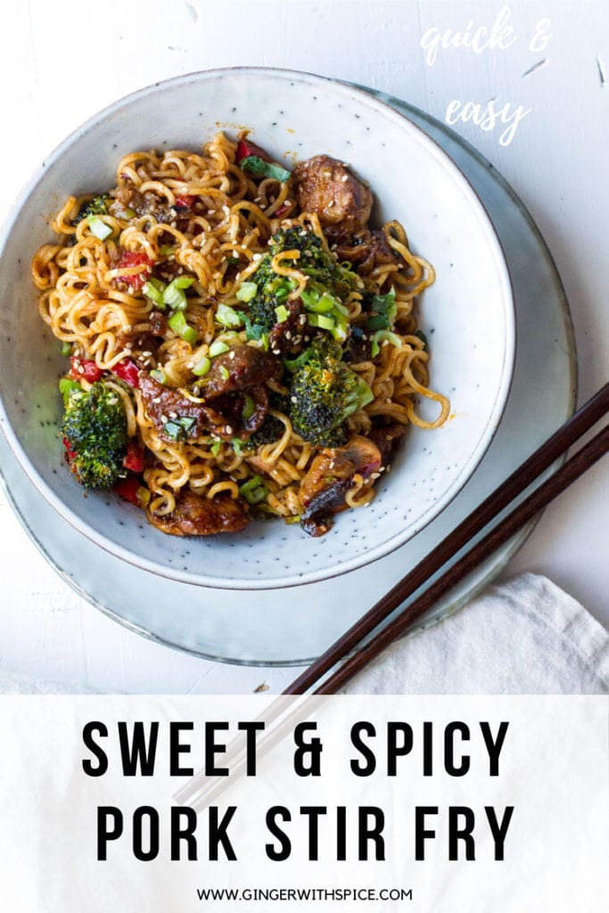 Bowl with pork stir fry and noodles. Chopsticks on the side. Pinterest pin.