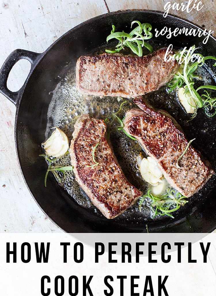 3 striploin steaks in a cast iron skillet with rosemary and garlic. Pinterest pin.