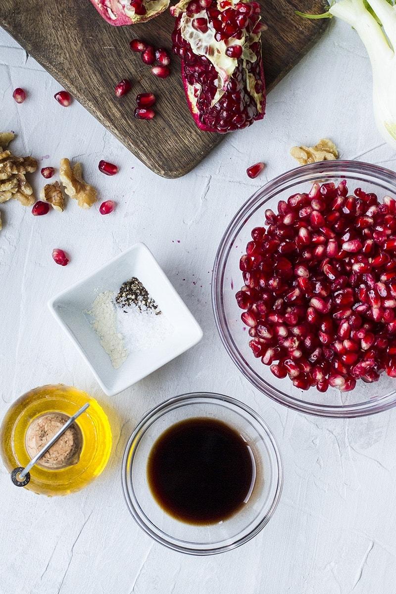 Ingredients to make pomegranate vinaigrette.