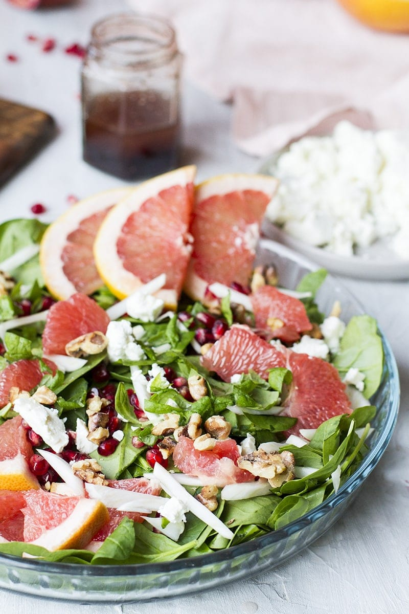 Grapefruit salad in a shallow pan, garnished with grapefruit slices.