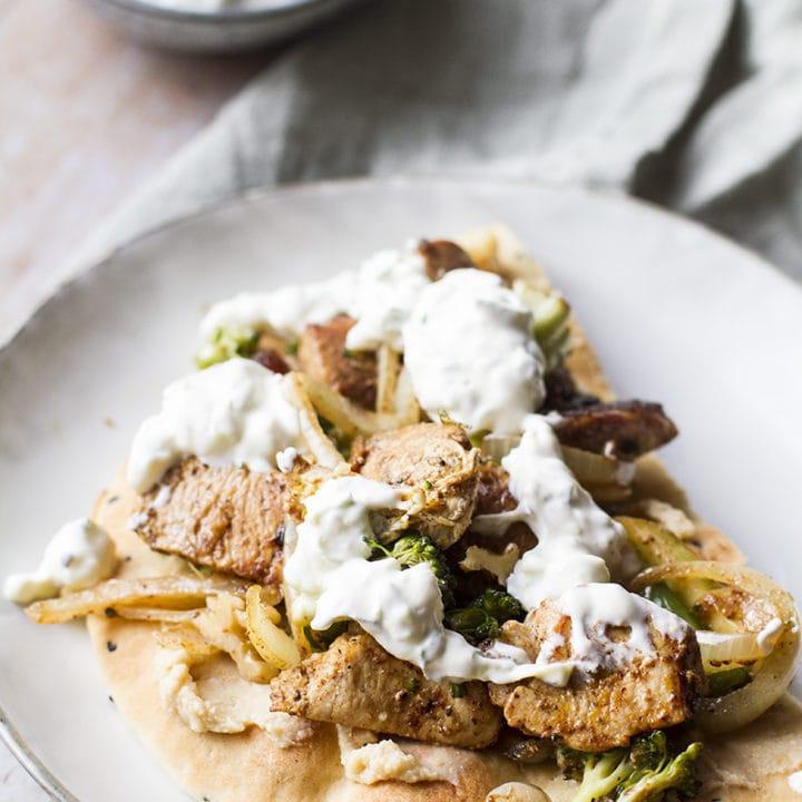 Shawarma chicken and tzatziki on a naan.