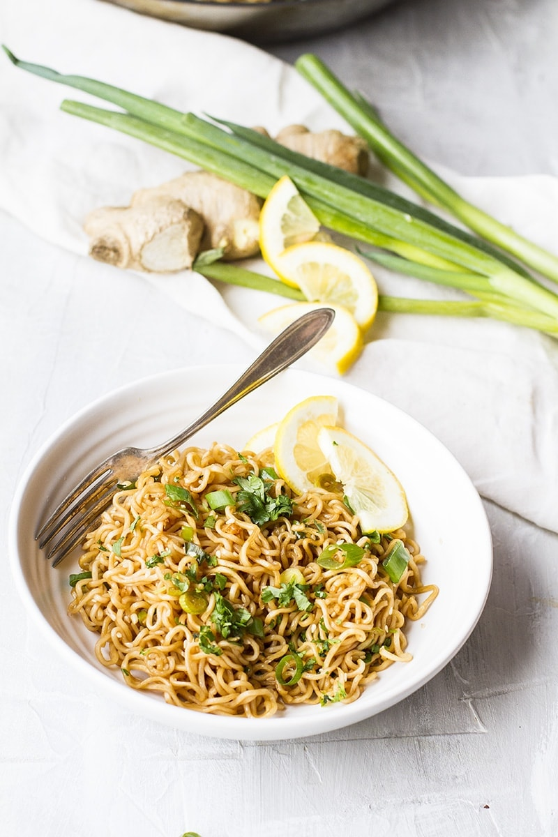 Bowl with lemon ginger sesame fried noodles.