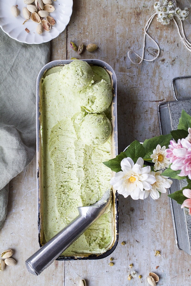 Flatlay of pistachio ice cream in a loaf pan.