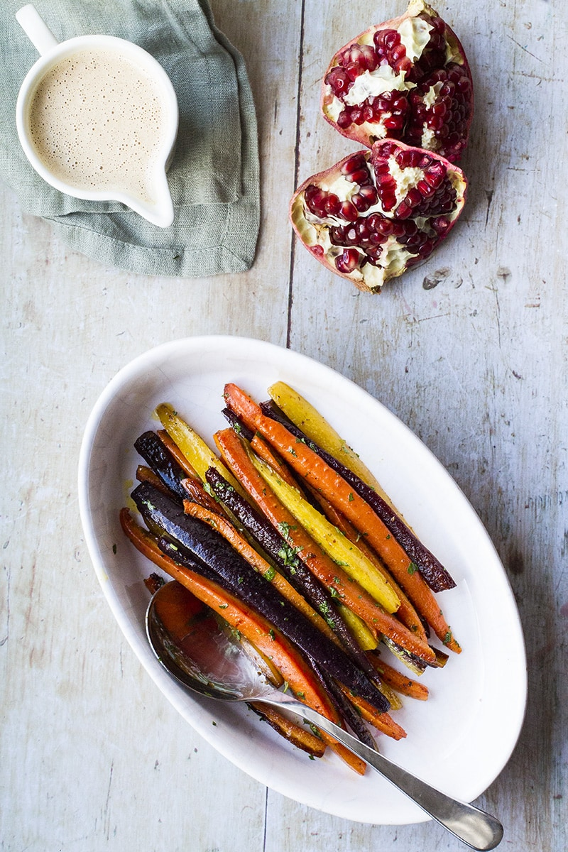 Yellow, purple and orange carrots in a pan.