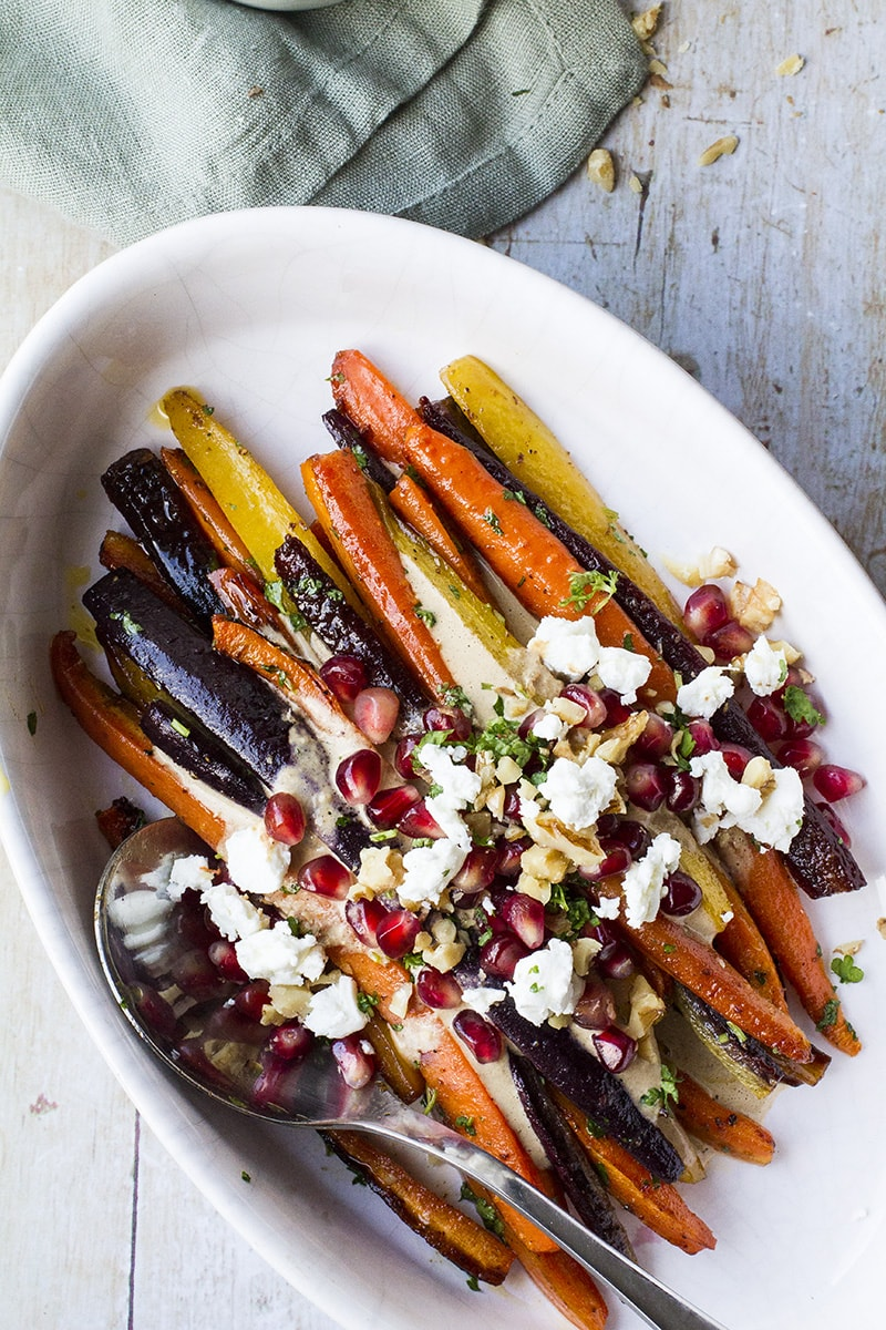 Roasted carrots topped with feta cheese, pomegranate arils and chopped walnuts.