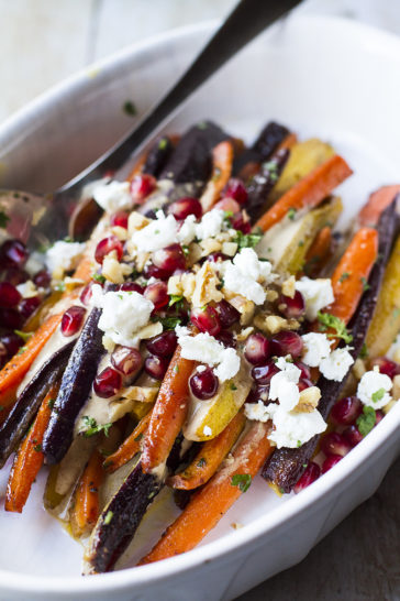 Close-up of the carrots with toppings like feta cheese and pomegranate arils.