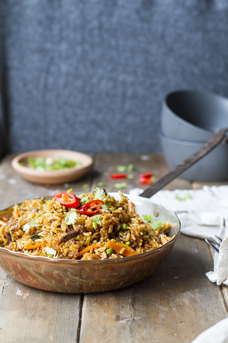 Copper skillet with fried rice.