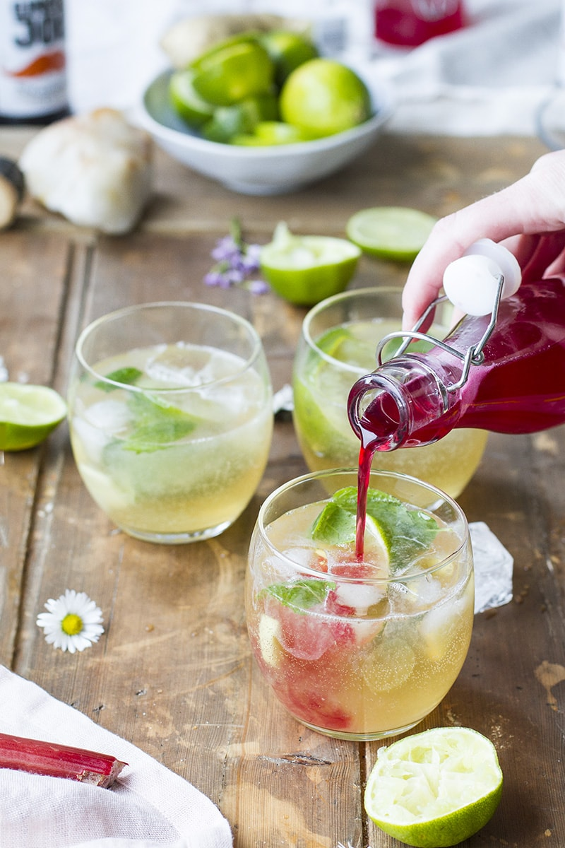 Pouring ginger rhubarb simple syrup into classic Moscow mule.