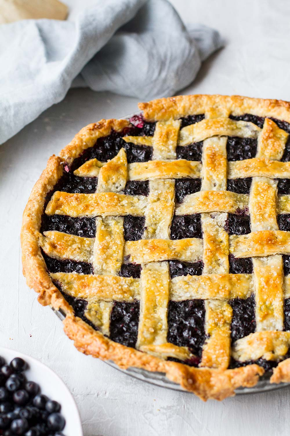Baked blueberry pie with lattice top, not showing all of it.