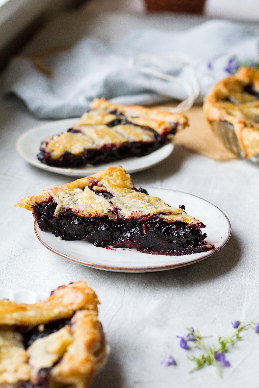 Three slices of blueberry pie.