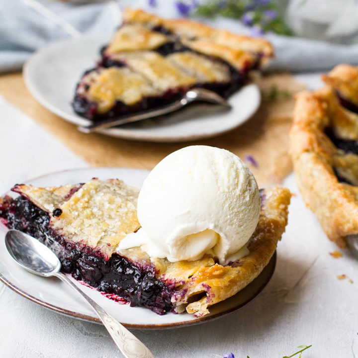 Slice of pie with a scoop of ice cream on top.