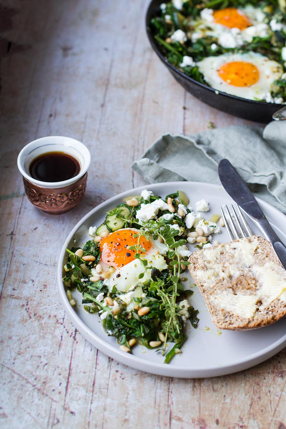 Serving suggestion for shakshuka, with half a ciabatta and Bosnian coffee on the side.