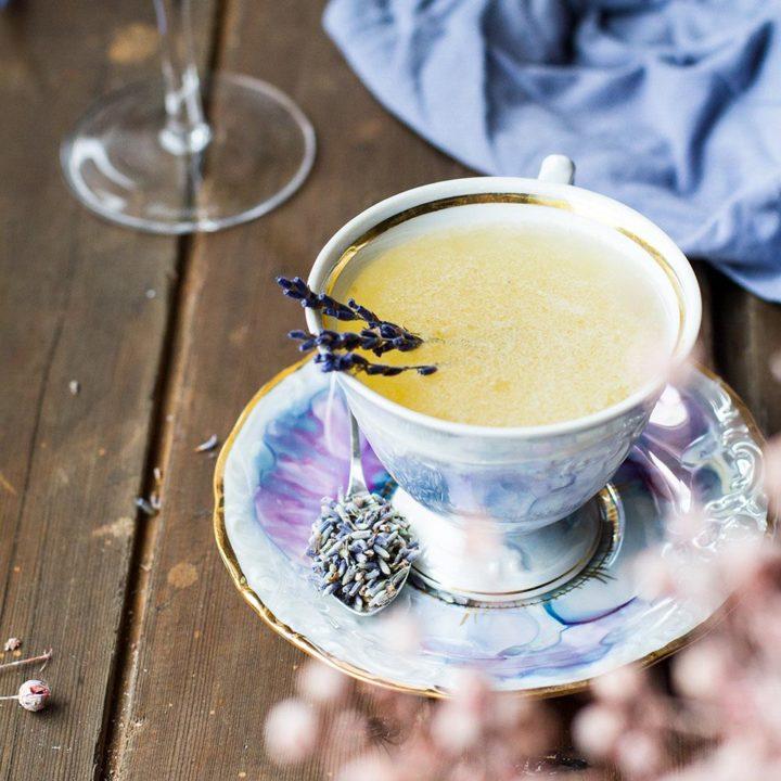 Purple tea cup with honey bee's knees.