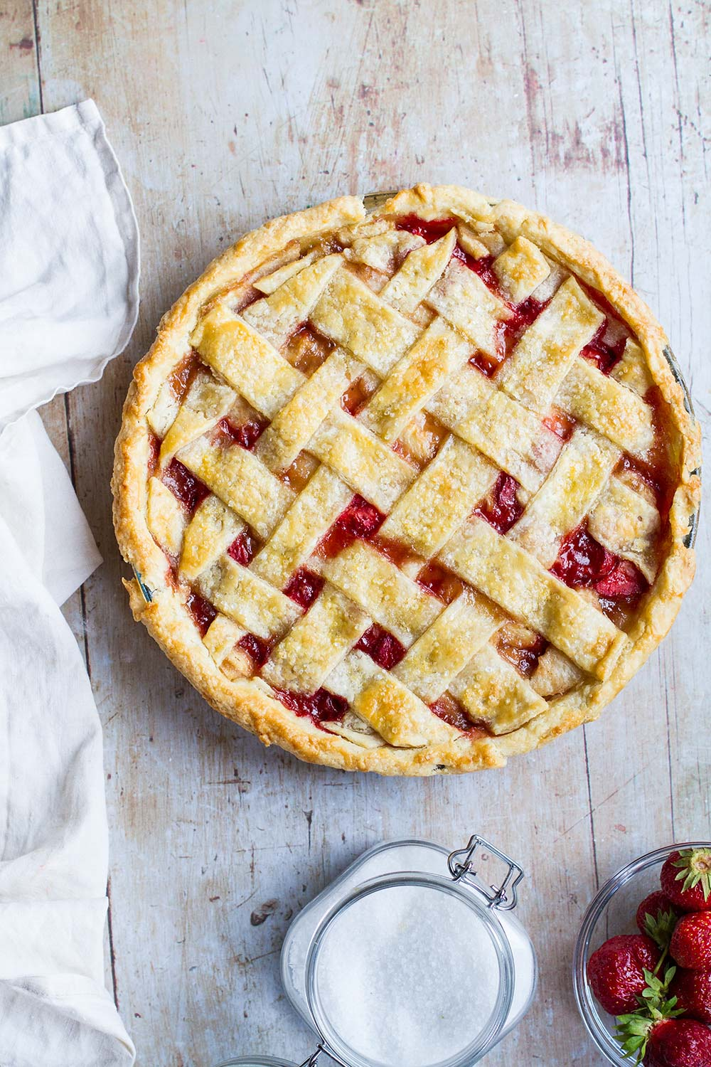 Strawberry peach pie seen from above.
