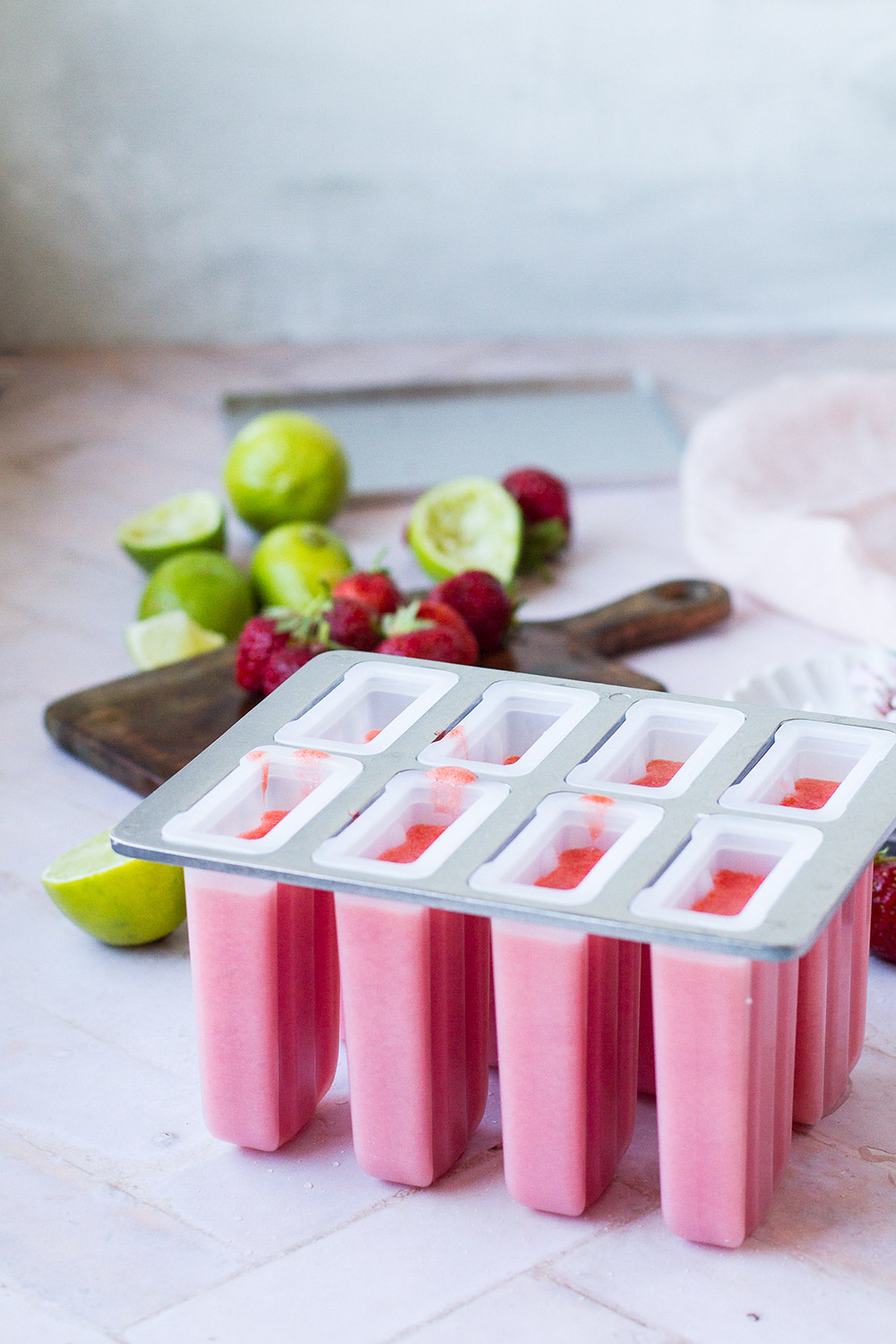 Ice cream tray with pink strawberry filling.