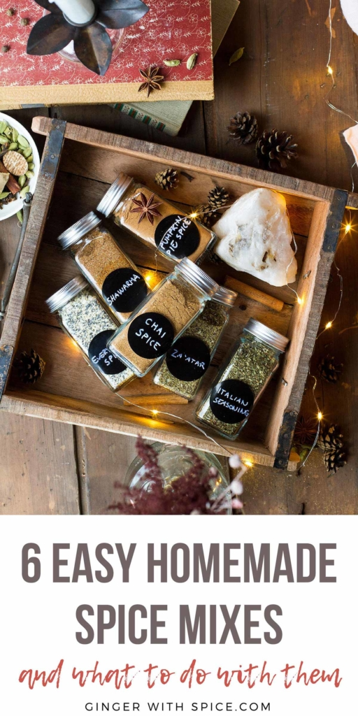 6 spice jars with homemade spices in a wooden box. Pinterest pin.