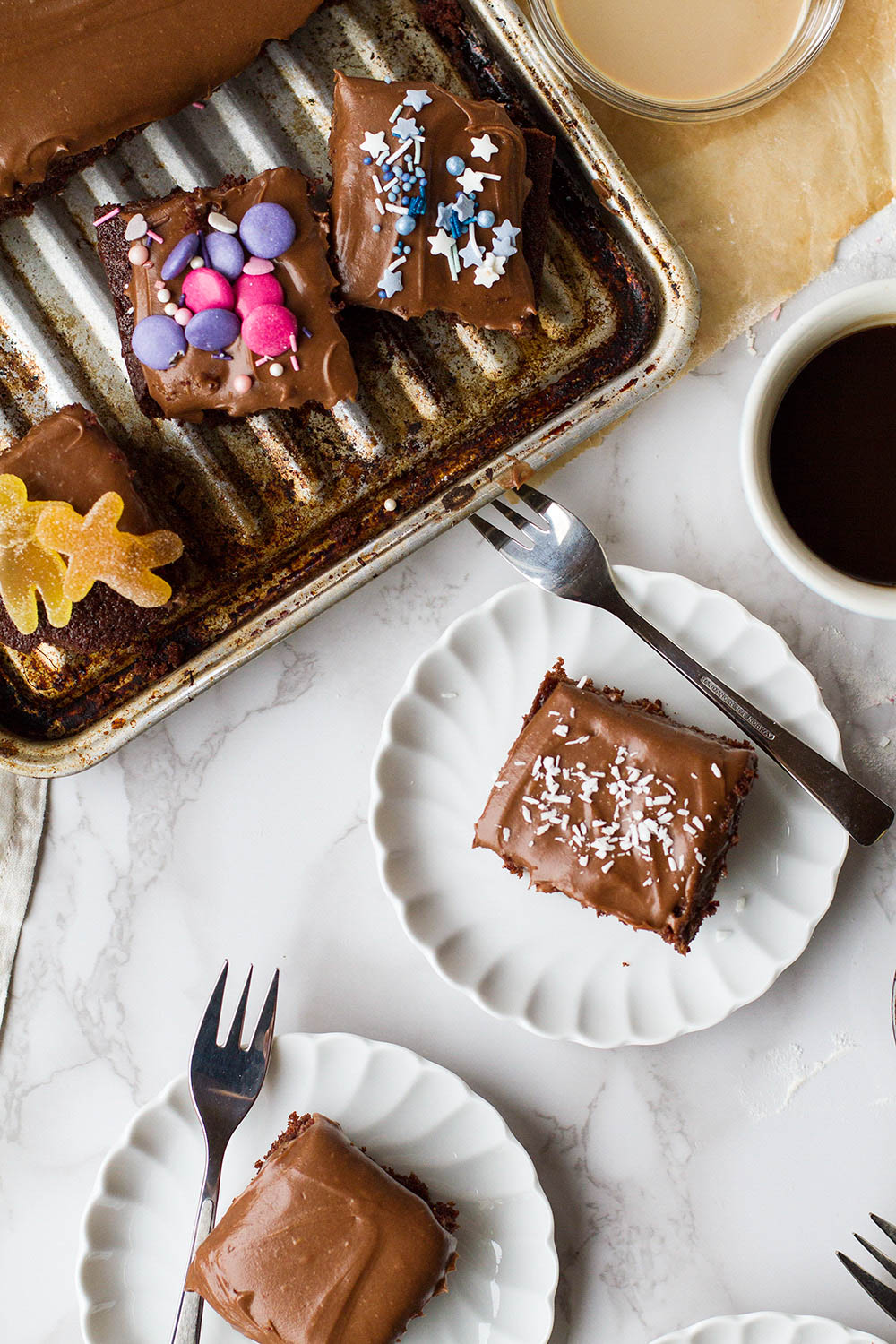 Several square chocolate cake slices with different toppings.