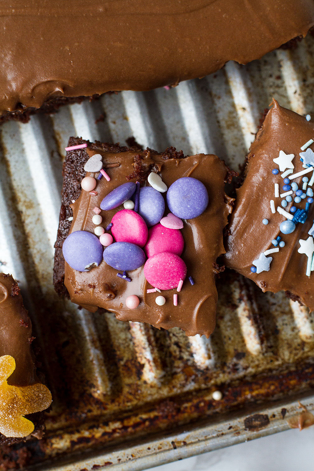 Chocolate cake topped with pink Smarties.